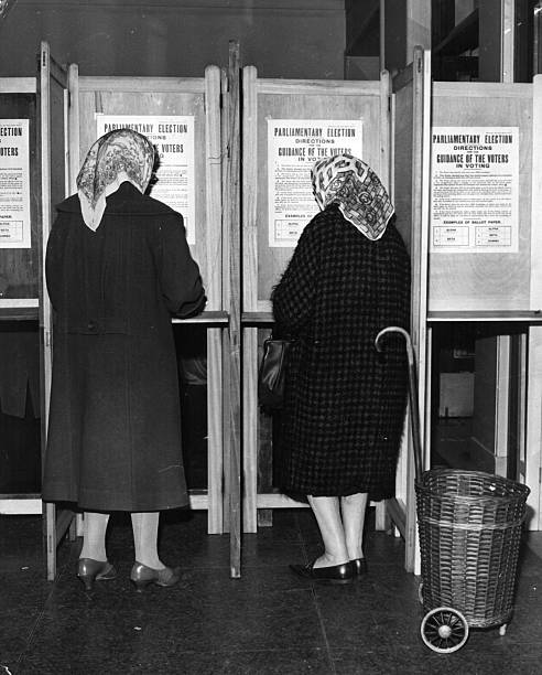 Two women voting in the polling booths at Lambeth Town...