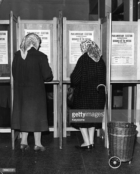 Two women voting in the polling booths at Lambeth Town Hall for the British General Election