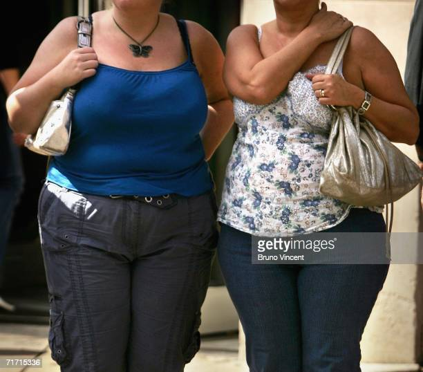 Two women wait to cross a road on August 25 2006 in London England The Department of Health have released a report that predicts the number of obese...