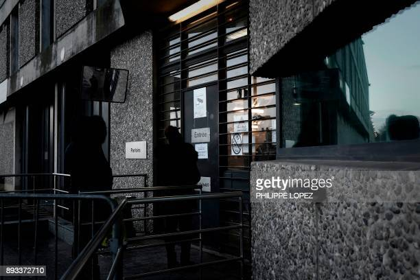 Two women wait to see relatives on December 14 at the entrance of the FleuryMerogis prison the largest prison in Europe located in the town of...