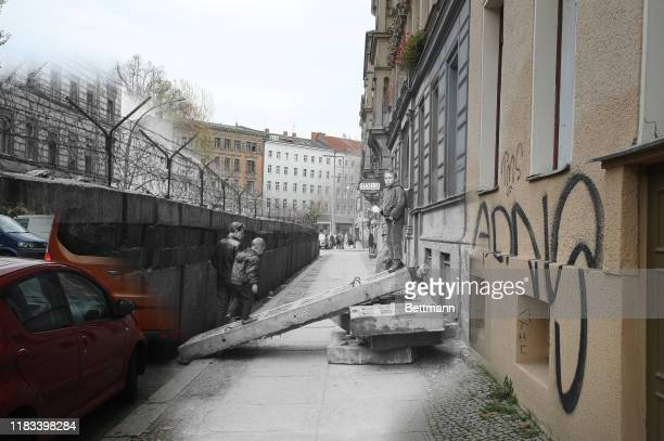 This digital composite image shows Sebastianstrasse in Berlin in 1963 and on October 21 2019 BERLIN GERMANY OCTOBER 21 Two women walk along...