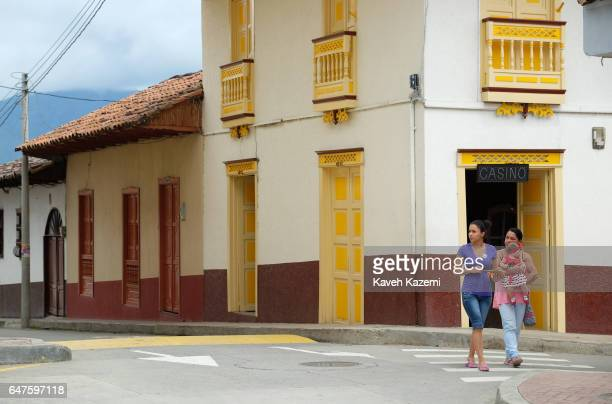 Two women walk into the main square on January 13 2017 in Santuario Colombia Santuario is a town and municipality in the Department of Risaralda...