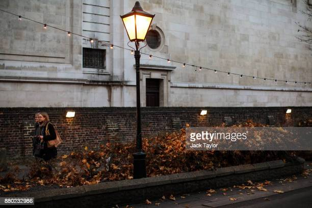 Two women walk past a church in Kensington on November 24 2017 in London England The American actress Meghan Markle will live at Nottingham Cottage...