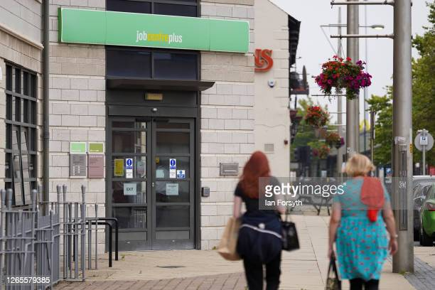 Two women walk past the Job Centre building on August 12, 2020 in Middlesbrough, United Kingdom. The Office For National Statistics reported the UK's...