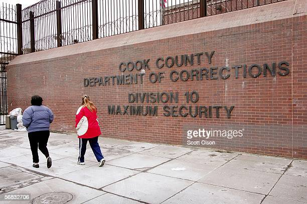 Two women walk toward a visitor's entrance of a maximum security detention area of the Cook County jail February 12 2006 in Chicago Illinois The...