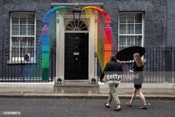 Two women walk towards the Pride Month installation around the doorway at 10 Downing Street on June 29, 2021 in London, England. The installation,...