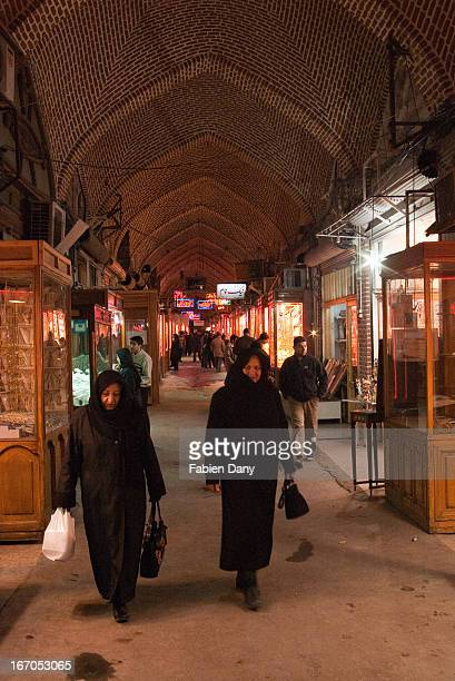 Two women walking in a covered alley of Tabriz Bazar, one of the biggest in the Middle East.