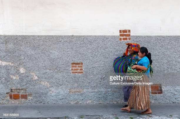 Two women walking in street, Antigua, Sacatepequez, Guatemala
