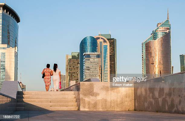 CONTENT] Two women walking in the centre of Astana at the end of the day Astana Kazakhstan July 2013