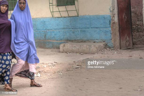 Two Women Walking in Traditional Dress Showing Henna Tattoos - Somalia Africa