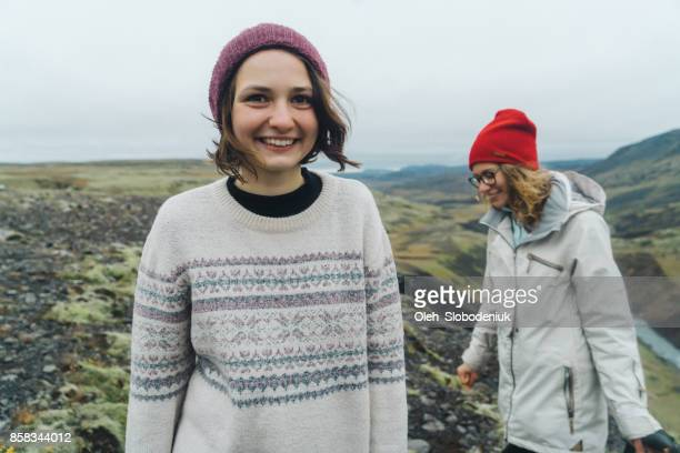 Two women walking near Haifoss  valley in mountains