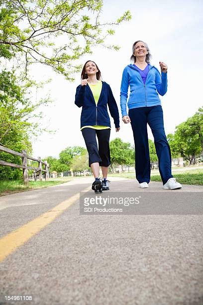 Two Women Walking on a Path - Low Angle View