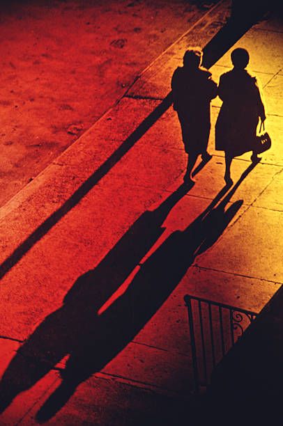 Two Women Walking On Pavement, Elevated View (B&W,red And Yellow Tone) Wall Art