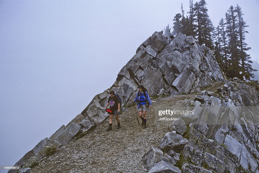 Two Hikers Walk the Pacific Crest Trail in Fog : Stock Photo