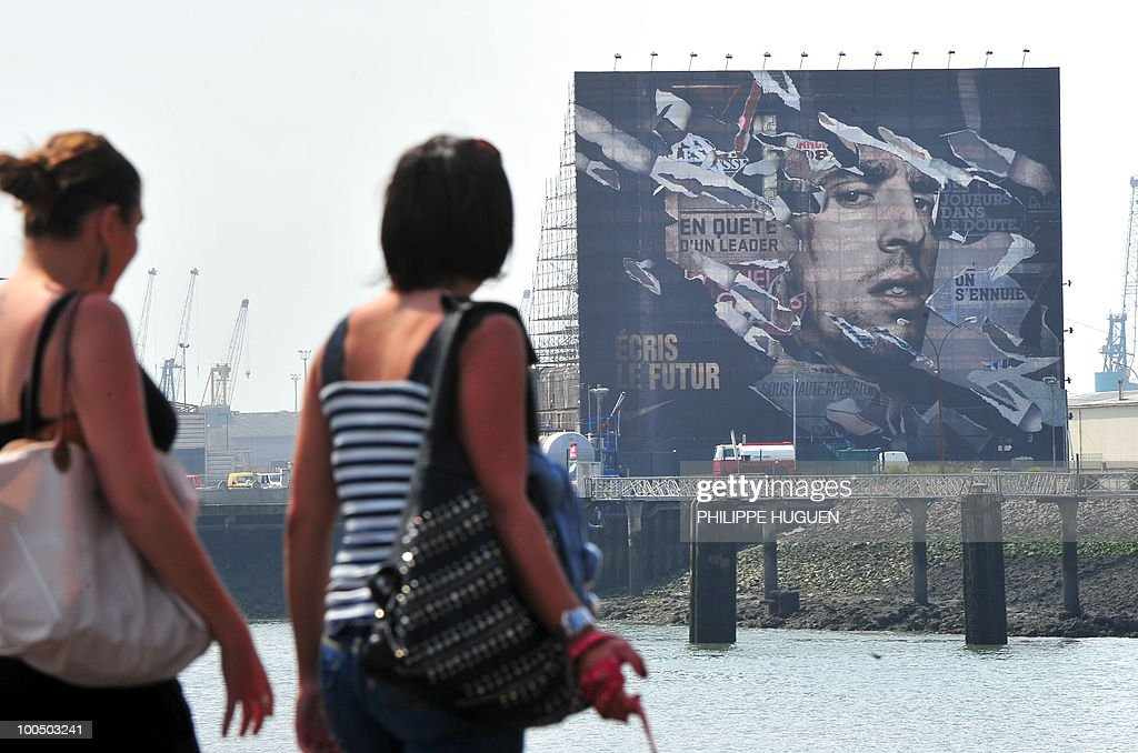 Two women watch a 800 m2 portrait of French football international Franck Ribery on May 25, 2010 in the northern city of Boulogne-sur-Mer, the place where the 27-year-old player of the Bayern's Munich was born. The project faced controversy when the Northern Pas-de-Calais region called to stop it after Ribery was questioned by French police during an investigation into the under-age call-girl scandal which has rocked the France football team.