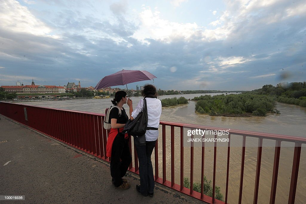 Two women watch from a bridge high water level of Wisla river in Warsaw on May 20, 2010. Flash floods caused by days of heavy rainfall have hit parts of central Europe, killing at least seven people, disrupting power supplies and forcing thousands of people from their homes. Southern Poland, parts of the Czech Republic and Slovakia and northern Hungary are among the worst affected regions