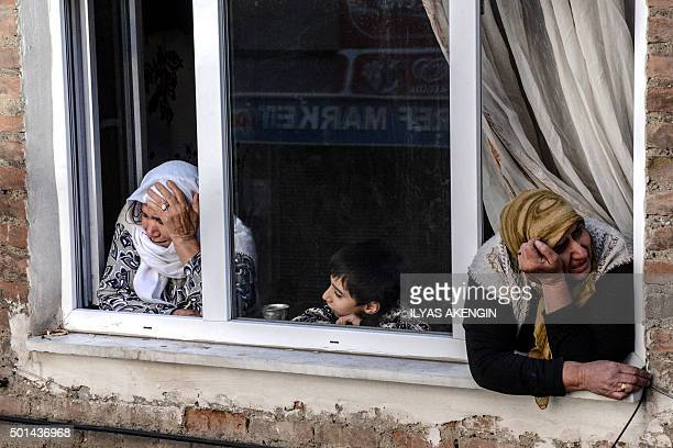 TOPSHOT Two women watch the funeral of killed protestors Serdil Cengiz and Siyar Salman during their funeral procession on December 15 in the city of...
