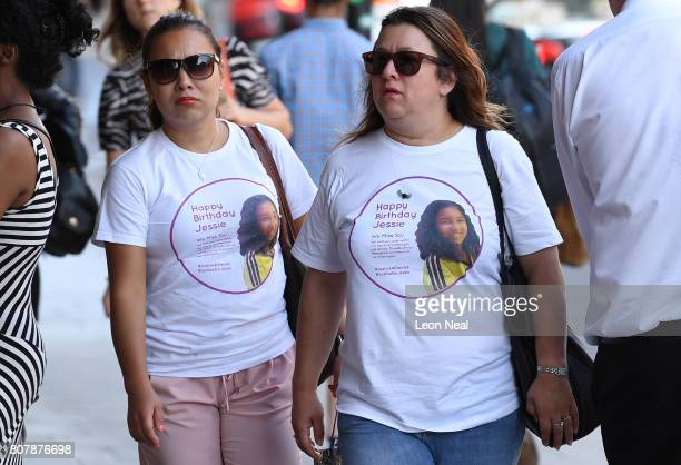 Two women wear tribute shirts to 12-year-old Jessica Urbano, who lived on the 20th floor of Grenfell Tower, as they gather outside ahead of a...