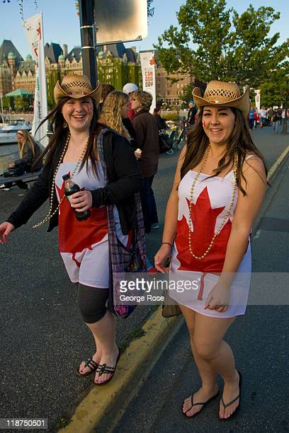 Two women wearing cowboy hats and Canadian flag dresses await the Canada Day inner harbour fireworks show on July 1 2011 in Victoria British Columbia...