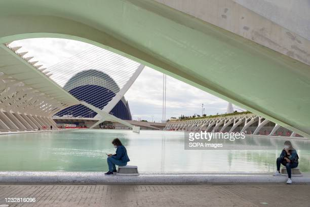 Two women wearing face masks wait to get vaccinated at the City of Arts and Sciences of Valencia. The good rate of vaccination in the Valencian...