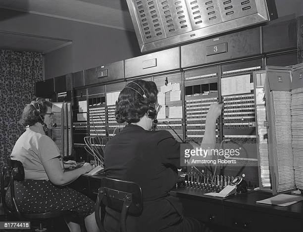 Two women wearing headsets, working on telephone switchboard. (Photo by H. Armstrong Roberts/Retrofile/Getty Images)