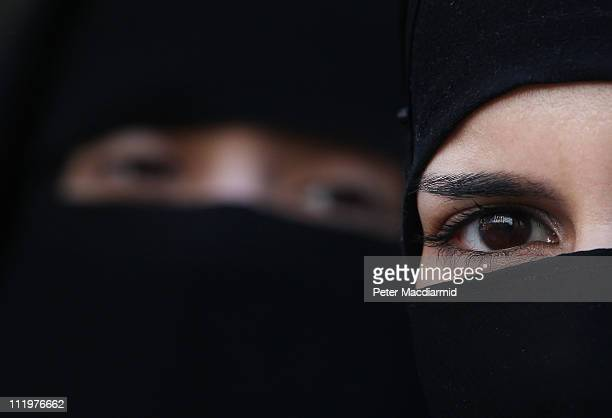 Two women wearing Islamic niqab veils stand outside the French Embassy during a demonstration on April 11, 2011 in London, England. France has become...