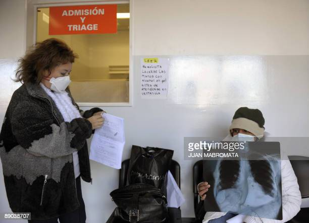 STORY Two women wearing masks wait for medical attention in a special ward for patients with Influenza A H1N1 virus symptoms at the Hospital Posadas...