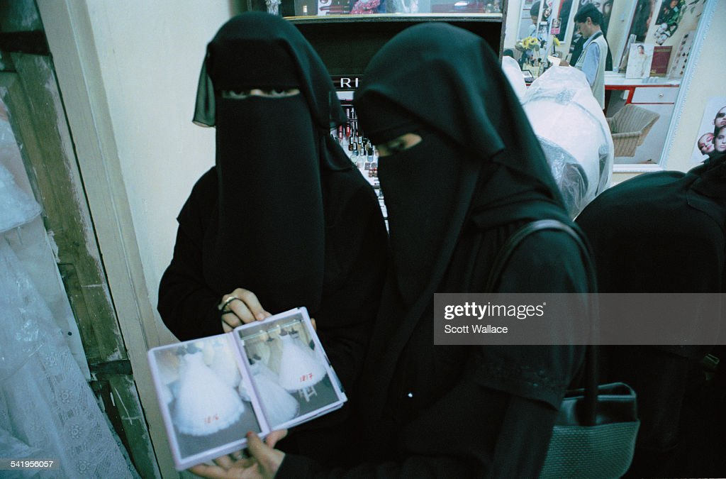 Two Women Wearing The Abaya And Niqab Visit A Wedding Dress Shop In Aden Yemen