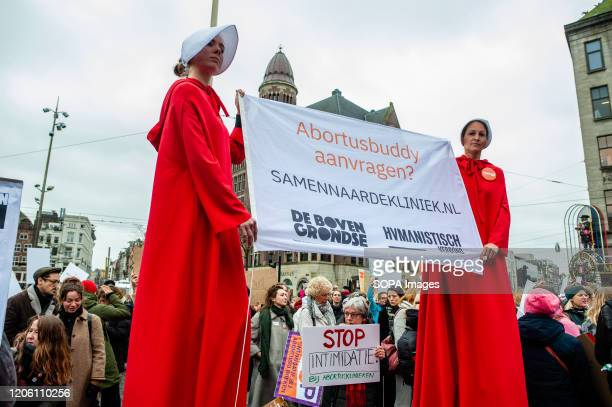 Two women wearing the Handmaid´s Tale costumes hold a big placard during the demonstration. During the International Women's day, thousands of women...