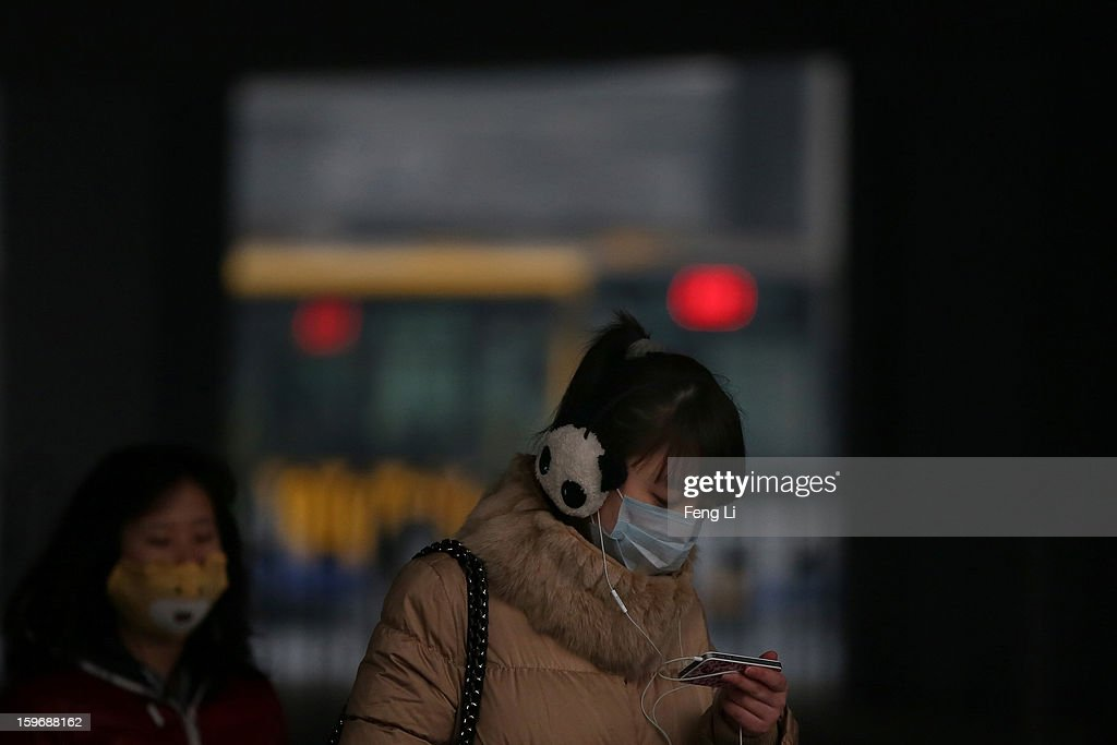 Two women wearing the mask walk on the street during severe pollution on January 18, 2013 in Beijing, China.