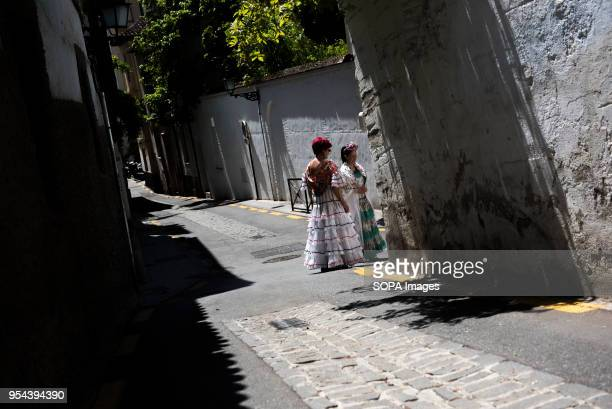 Two women wearing typical flamenco dress seen in a street of El Realejo neighbourhood during the Dia de las Cruces El día de la Cruz Día de las...