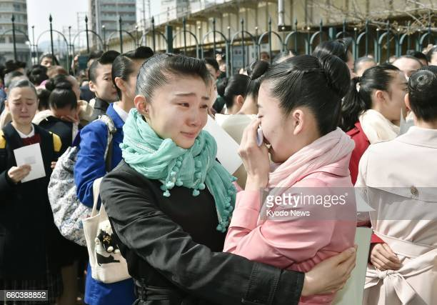 Two women weep in joy after learning they have passed tests to enter the Takarazuka Music School the institution to train young women for two years...