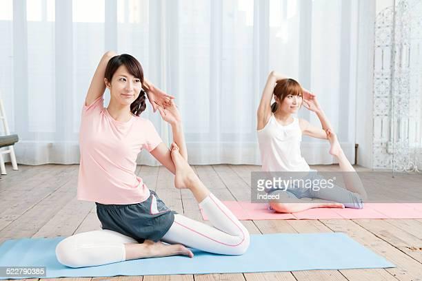 Two women who do yoga