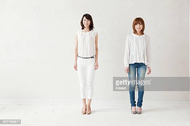 Two women who make a pose