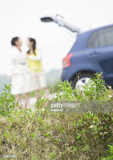 Two women with a car