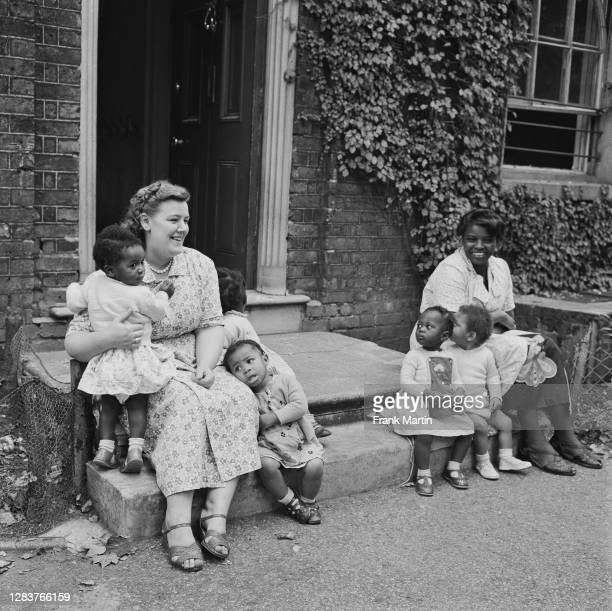 Two women with a group of children at a day nursery in the Notting Hill area of west London, circa 1958.
