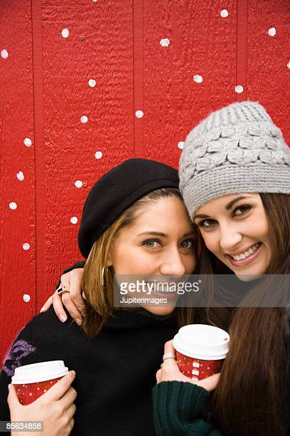 Two women with hot beverages
