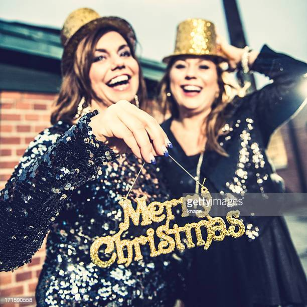 Two women with merry christmas sig