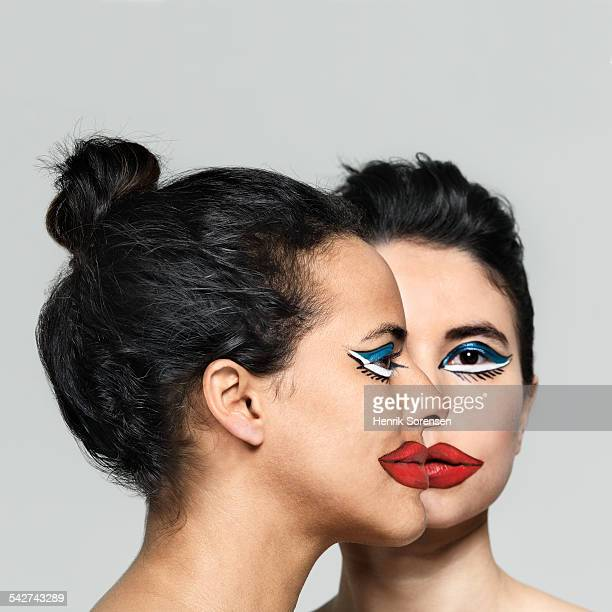Two women with paint on their faces