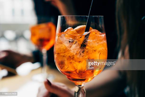 two women with spritz drinks - alcohol stock pictures, royalty-free photos & images