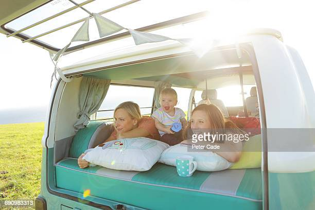 two women with toddler in back of camper van -  lgbtqi ストックフォトと画像