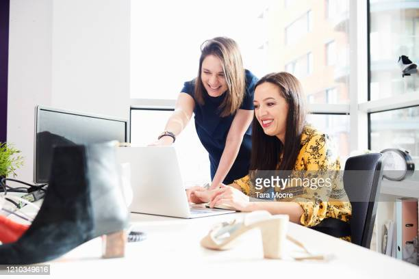 two women working in designer's office - employee engagement stock pictures, royalty-free photos & images