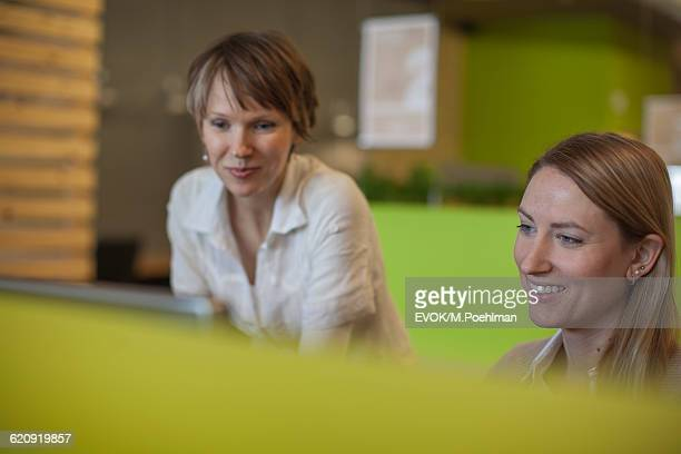 Two Women working together on computer in industrial office