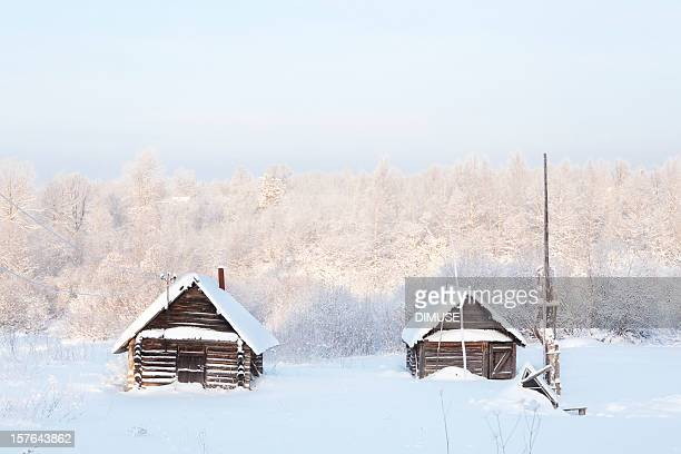 Two wooden house in the snow
