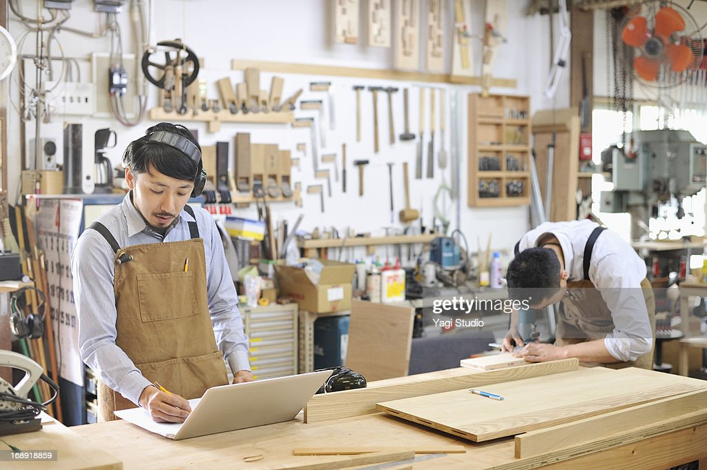 Two Woodworkers Making Furniture In Workshop : Stock Photo