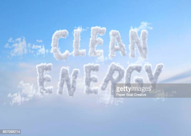 two words clean and energy shaped from white clouds seen up in the sky - typographies stock photos and pictures