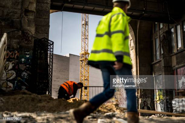 Two worker are pictured on a construction site on April 24 2019 in Berlin Germany
