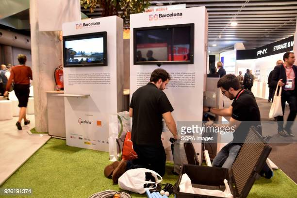 Two workers dismantling a booth on the last day of the Mobile World Congress in Barcelona The Mobile World Congress 2018 is being hosted in Barcelona...