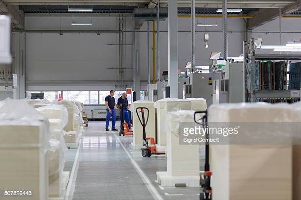 two workers in paper packaging factory - sigrid gombert stock pictures, royalty-free photos & images