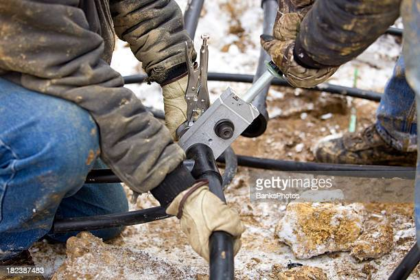 Two Workers Join Residential Geothermal Heating/Cooling Pipe